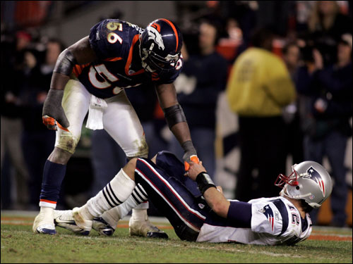 Al Wilson, great sportsman, helps up Tom Brady after sacking him.