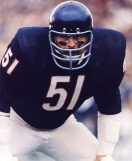 Dick Butkus would never have had a Gucci bag just look at him.